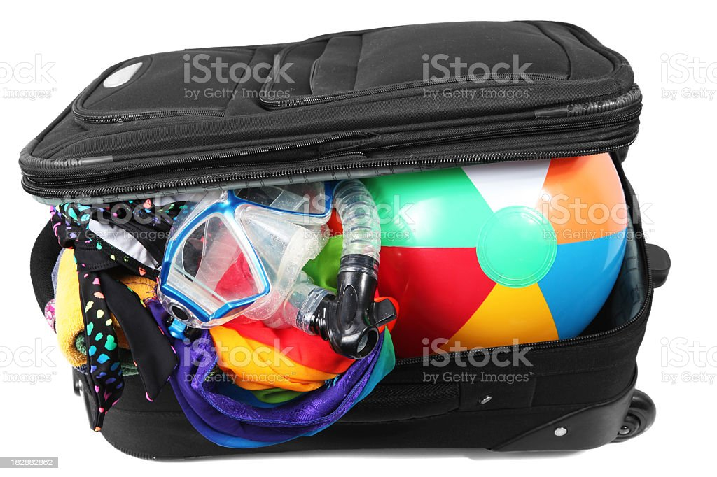 Luggage with beach ball and swimwear royalty-free stock photo