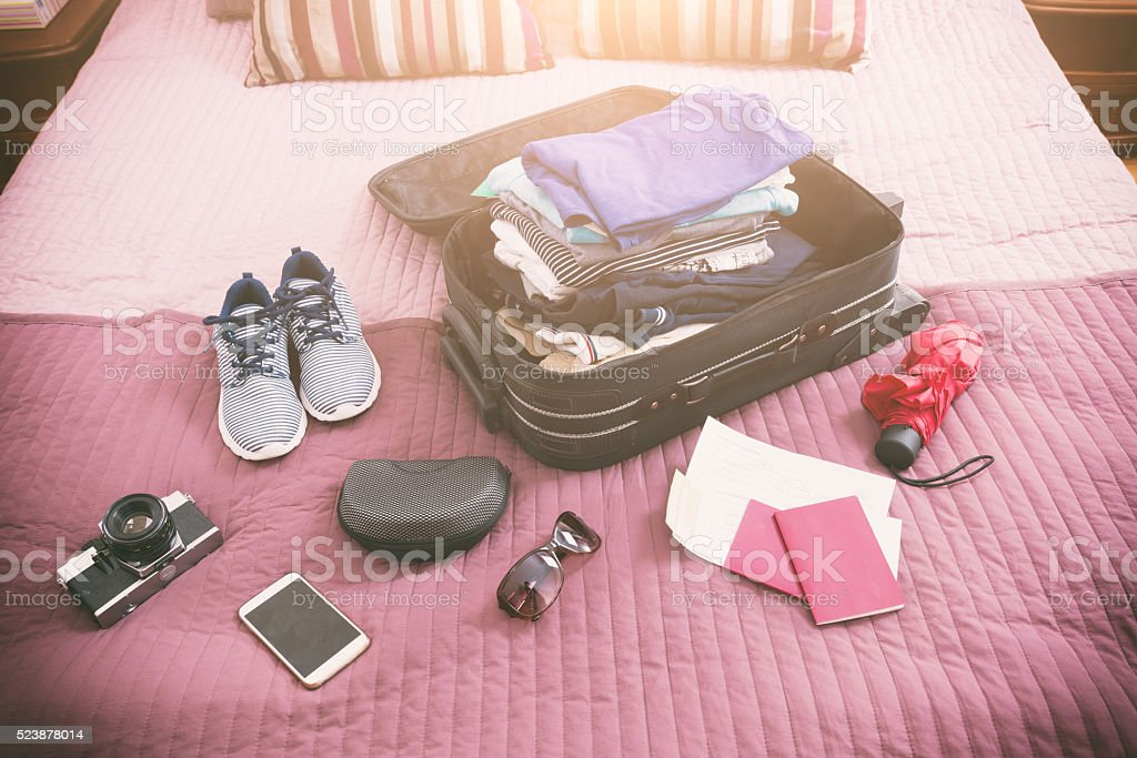 Luggage with clothes and other items stock photo