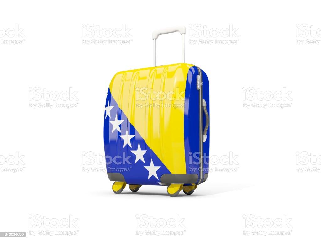 Luggage with flag of bosnia and herzegovina. Suitcase isolated on white stock photo