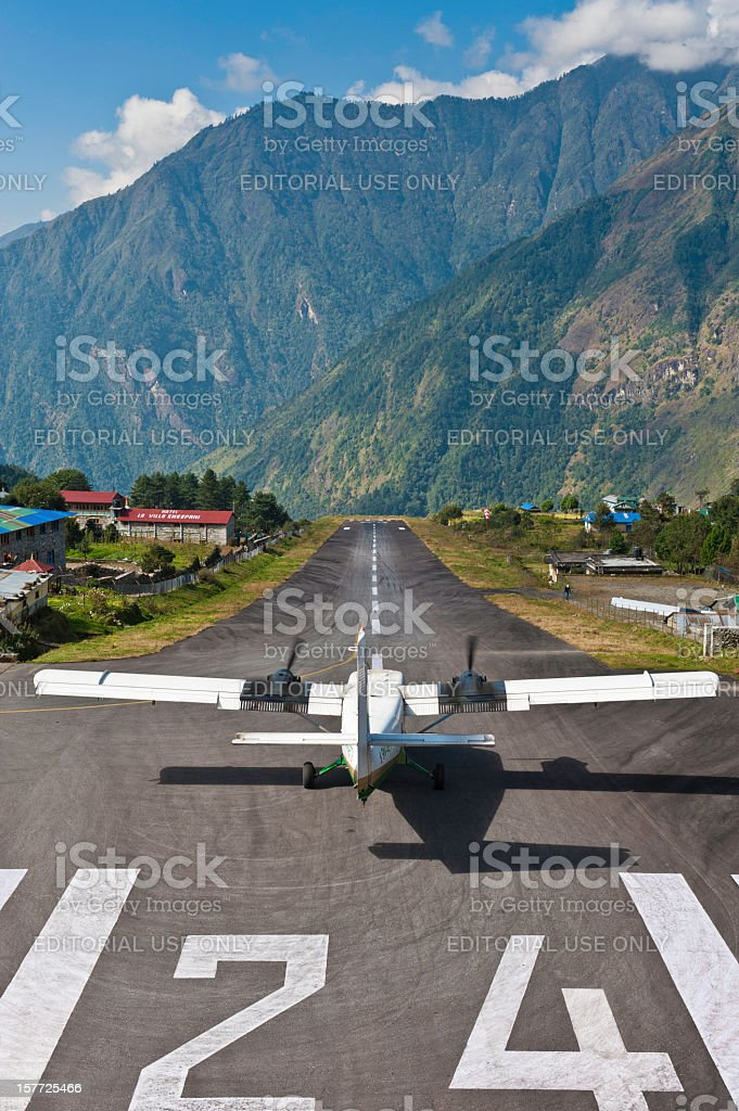 Lukla mountain airport dramatic runway take off Himalayas Nepal stock photo