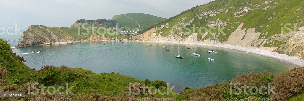 Lulworth Cove Dorset uk with boats Jurassic Coast panoramic view stock photo