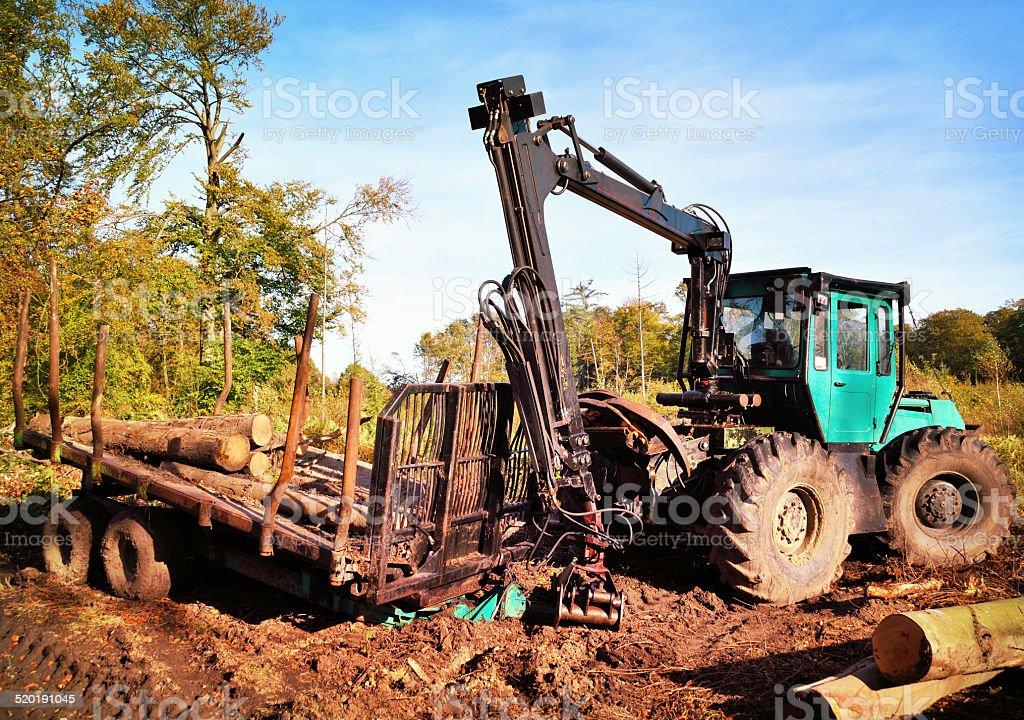 lumber industry tractor stock photo