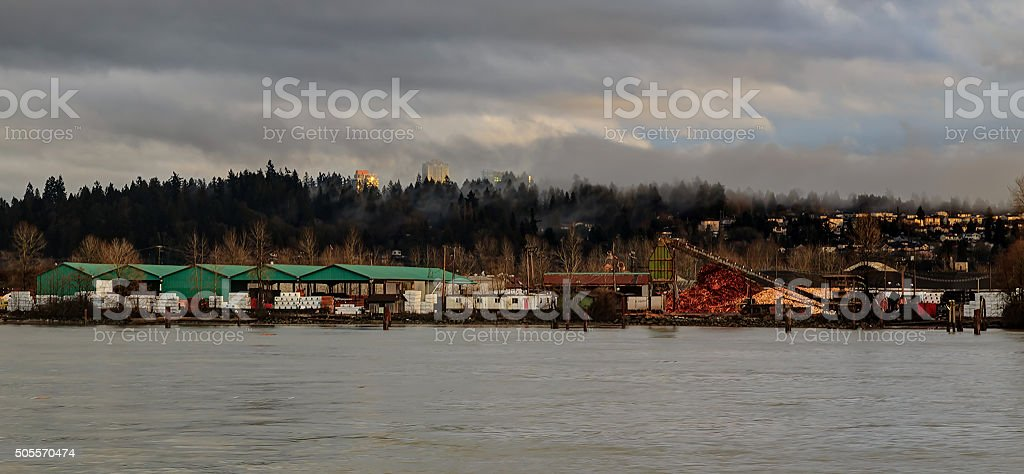 lumber mill by the river stock photo