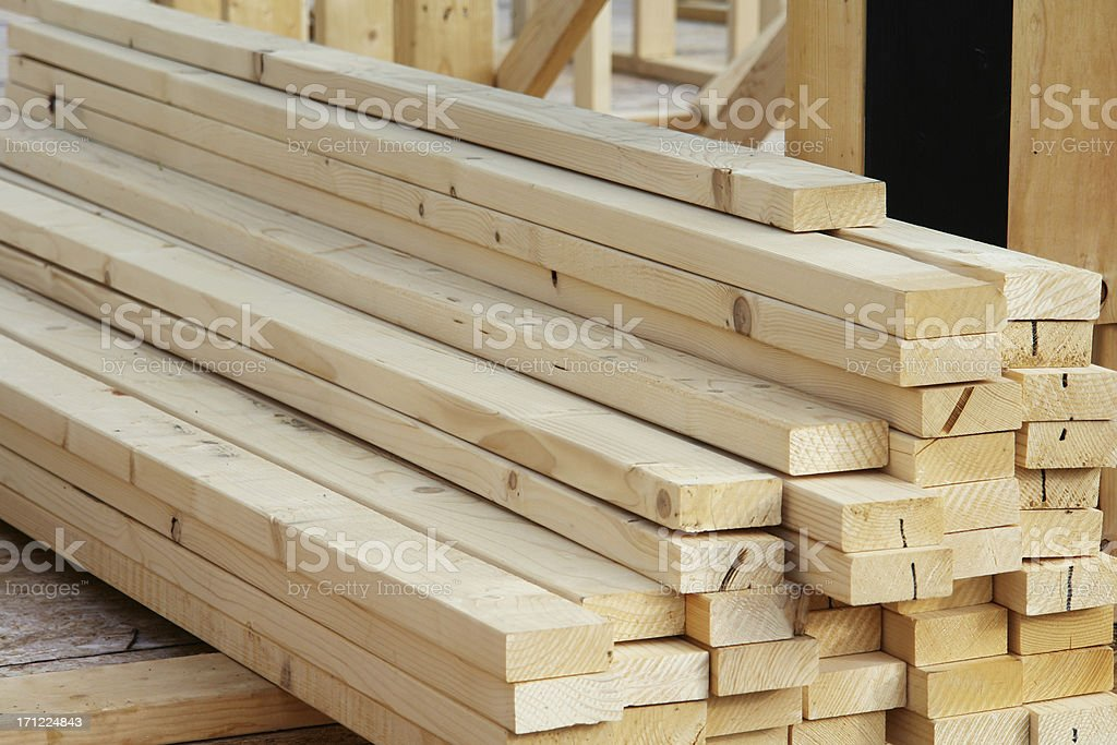 Lumber pile at construction site royalty-free stock photo