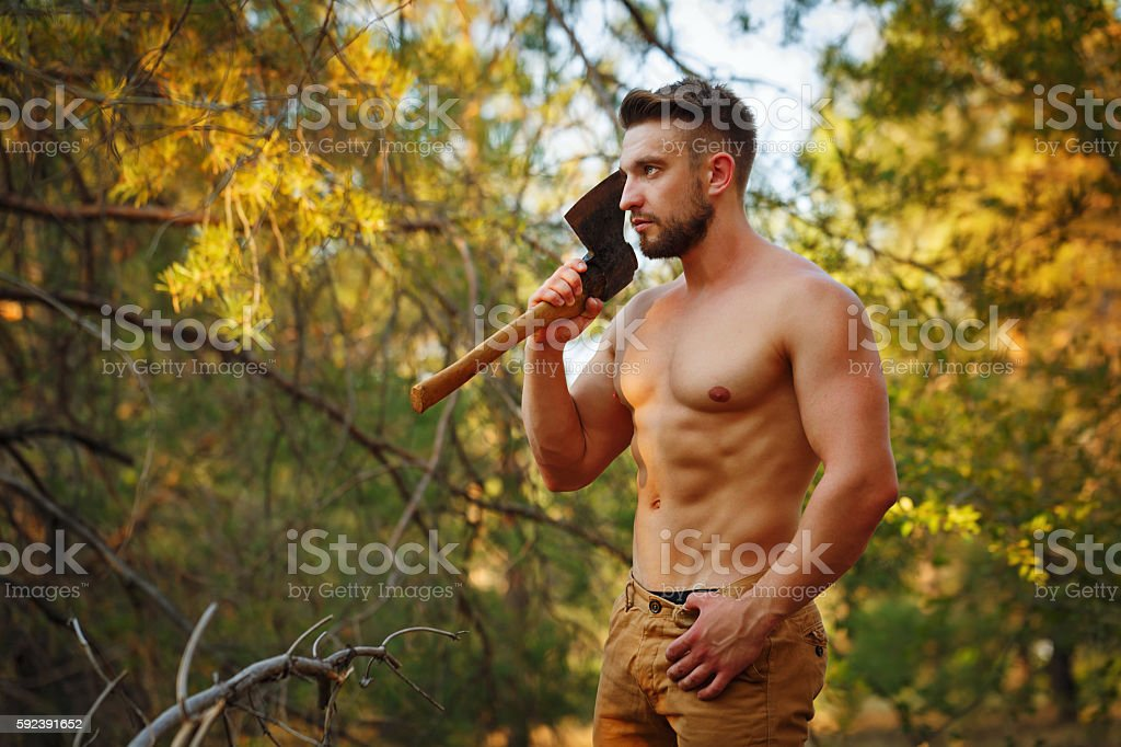 Lumberjack holds a cleaver. stock photo