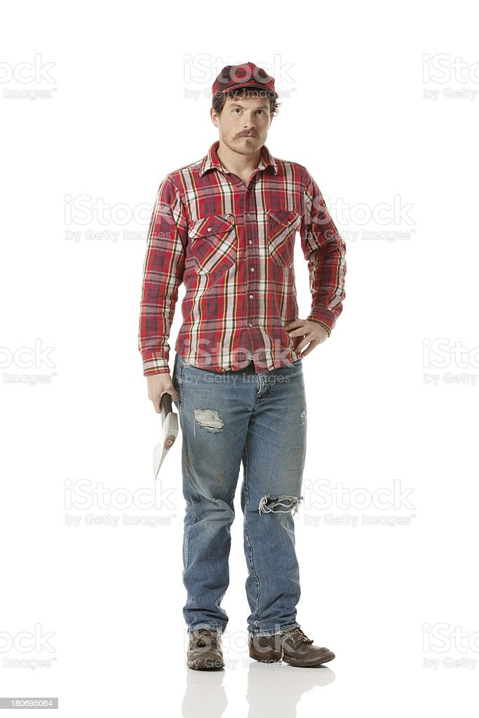 Lumberjack standing with an axe royalty-free stock photo