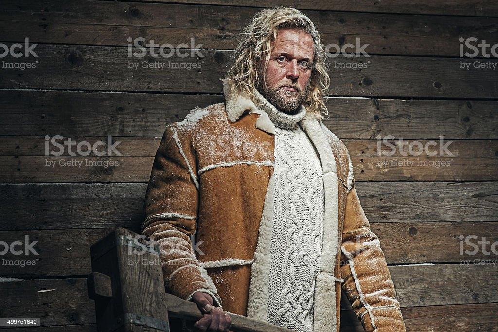 Lumberjack Winter Fashion Man Long Blonde Hair and Beard. stock photo
