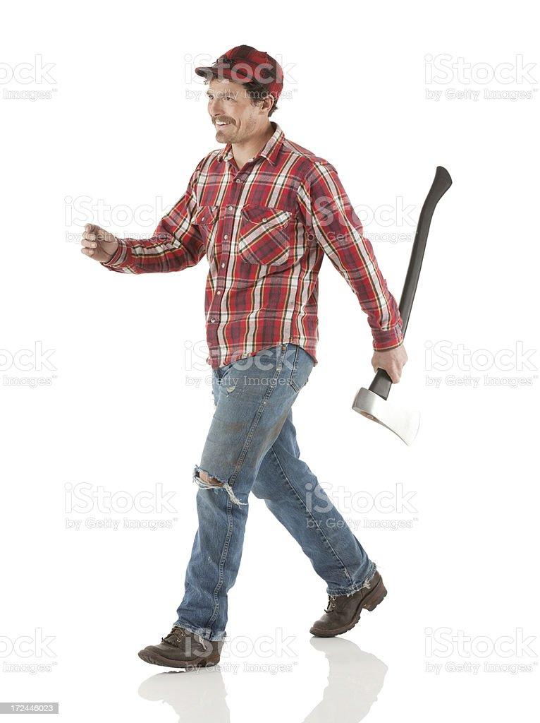 Lumberman walking with an axe royalty-free stock photo