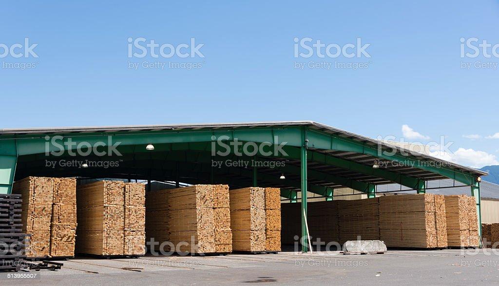 Lumberyard warehouse with stacks of cut boards-XXXL stock photo