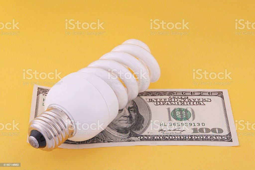 Luminescent lamp on hundred dollars stock photo