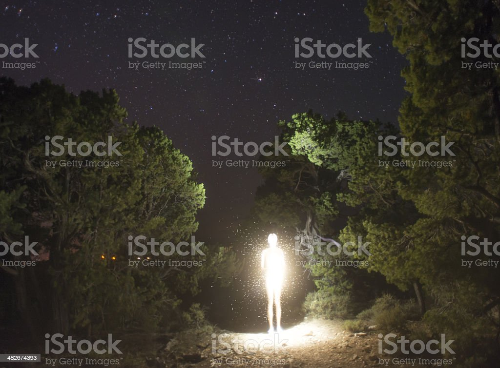 luminosity figure at night stock photo