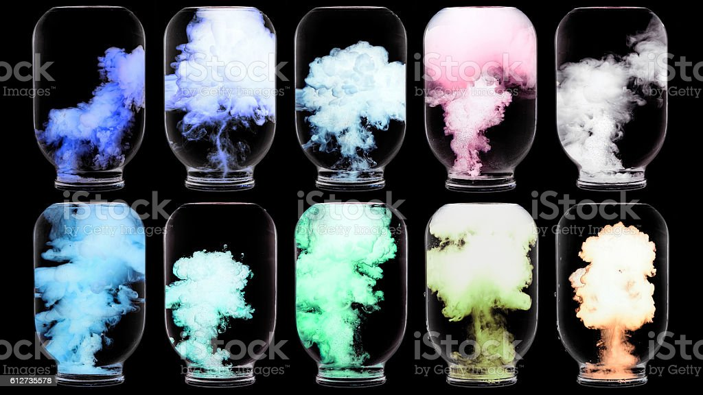 Luminous paint swirling in water. stock photo