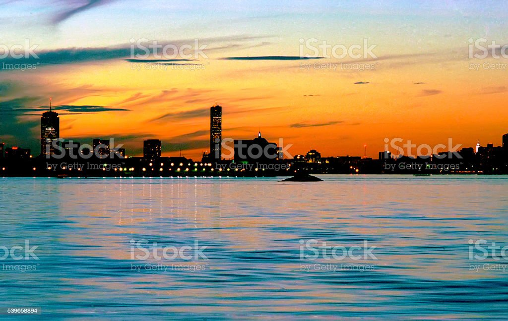 Luminous sunset over south Boston Harbor with the skyline and stock photo