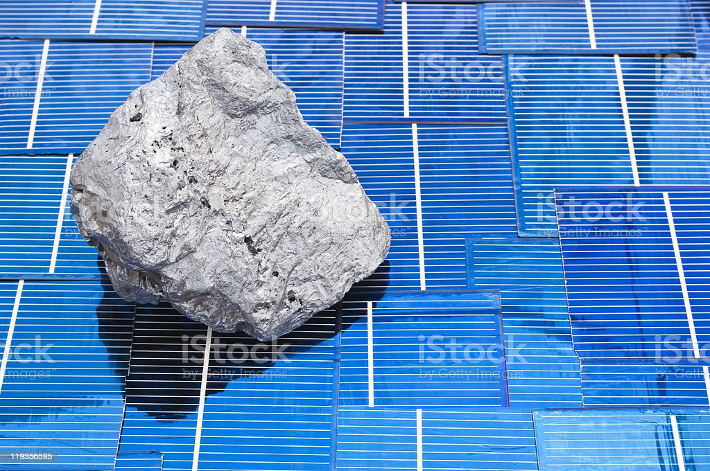 Lump of silicon on solar panels stock photo