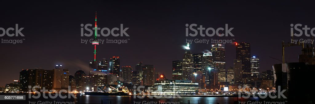 Lunar Eclipse Over The Bright Lights Of Toronto stock photo