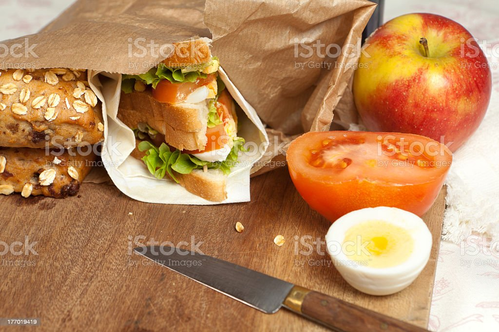 Lunch bag with sandwich made inside with tomatoes royalty-free stock photo