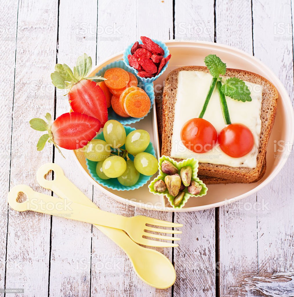 Lunch box for kids with fresh vegetables, fruits, nuts, berries stock photo