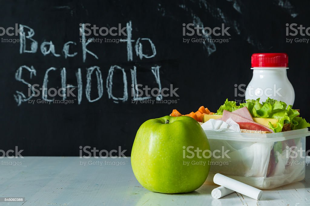 Lunch box with sandwich and fruits stock photo
