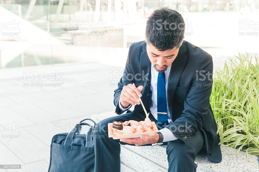 lunch break with sushi outside office stock photo