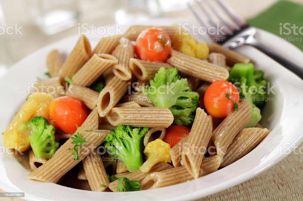Lunch consisting of whole wheat pasta and vegetables stock photo