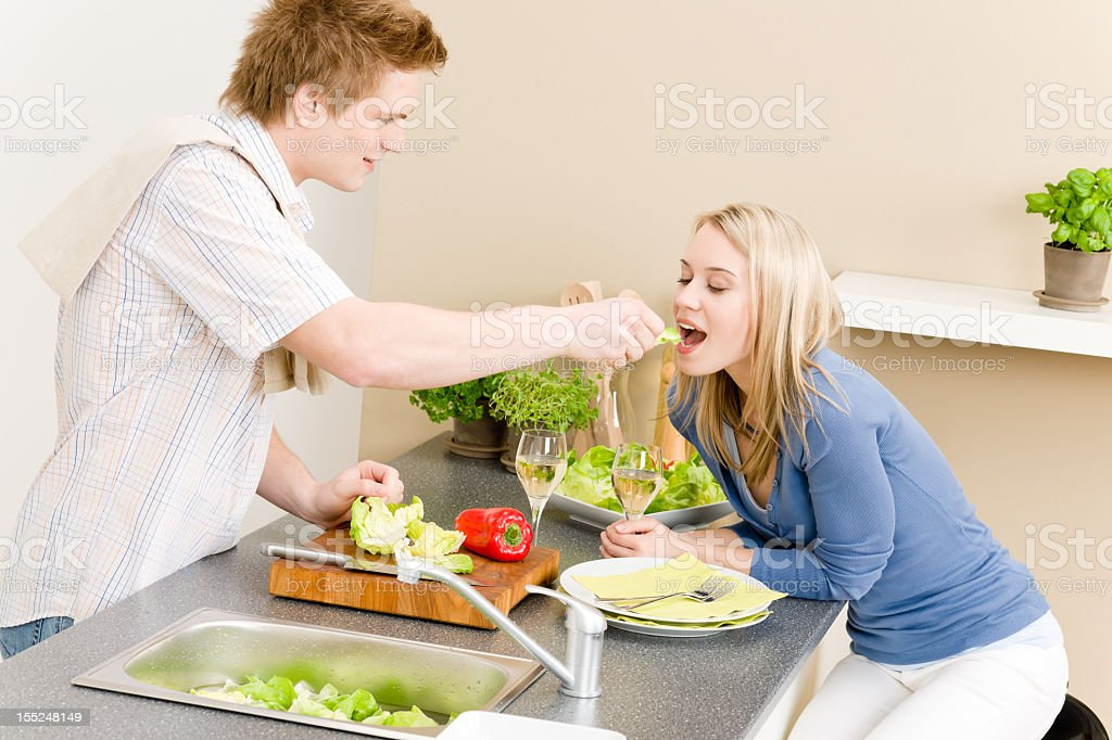 Lunch couple cook salad man feeding woman royalty-free stock photo