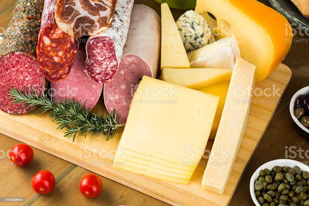Lunch meats and cheese assortment on table stock photo