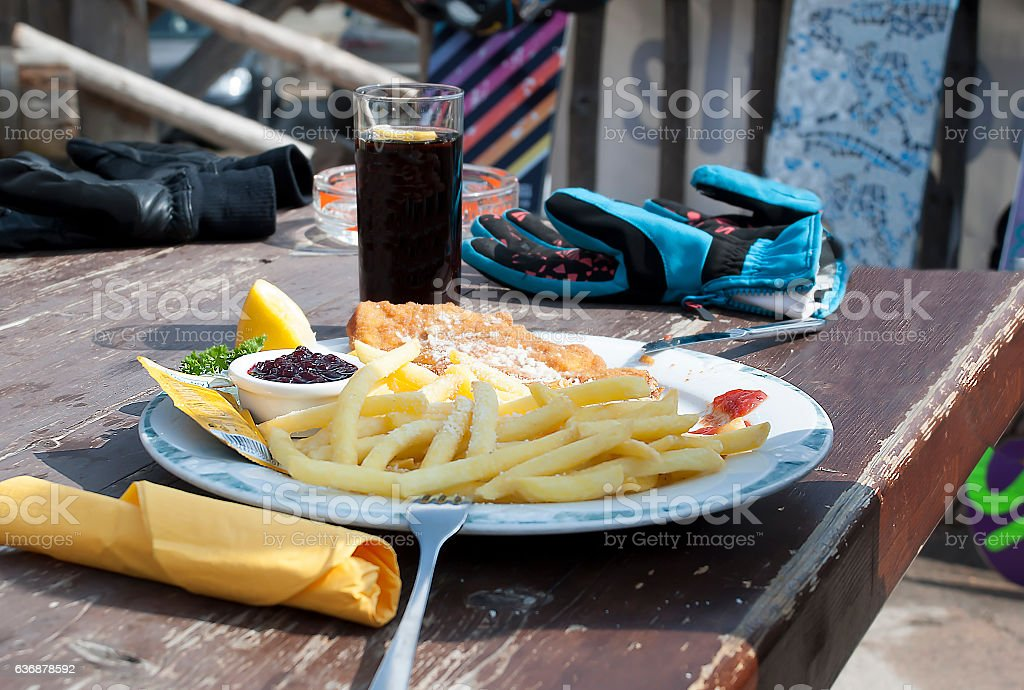Lunch of mountain skiers  in cafe on the mountain in Livigno. stock photo