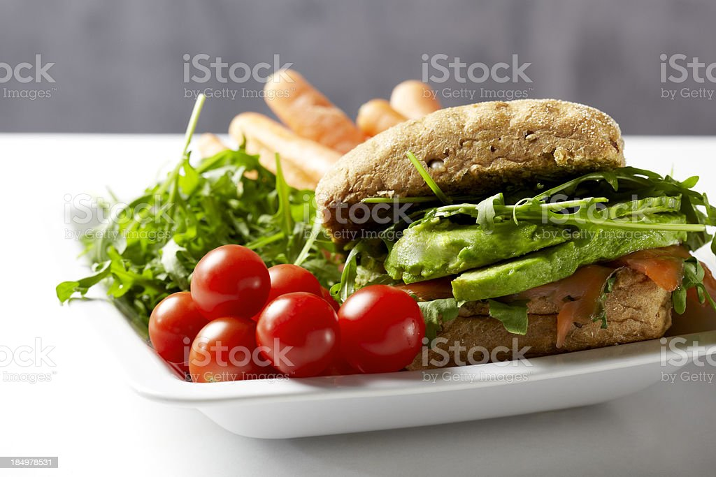 Lunch Plate with Salmon Sandwich and Vegetables royalty-free stock photo