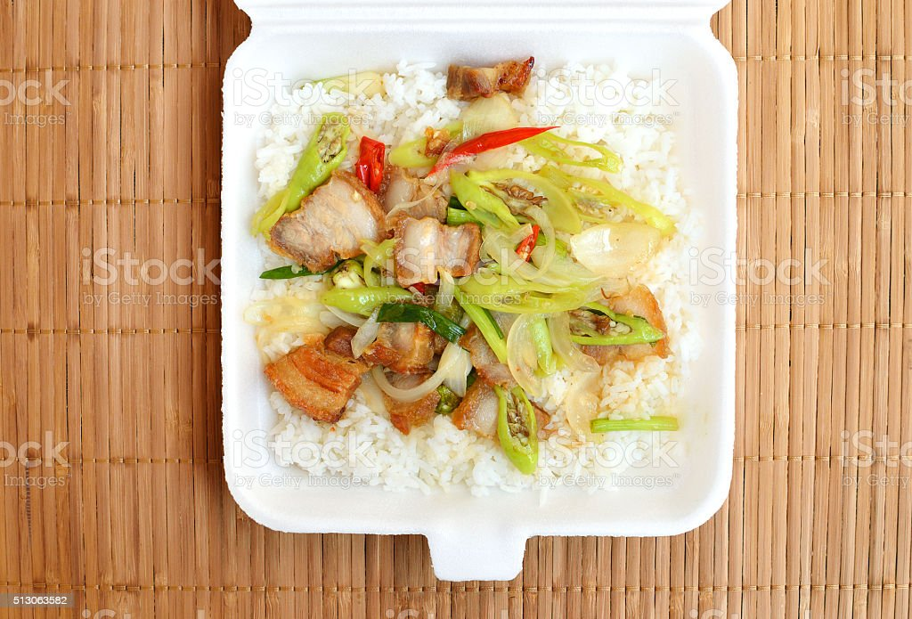 Lunch styrofoam box from fast food restaurant on mat background stock photo