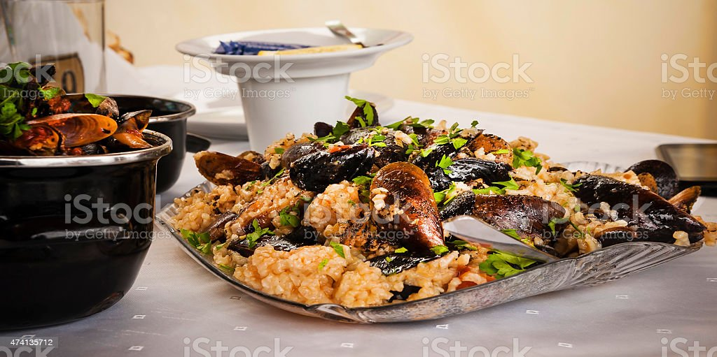 Lunch time. Mussels with rice on the table. stock photo
