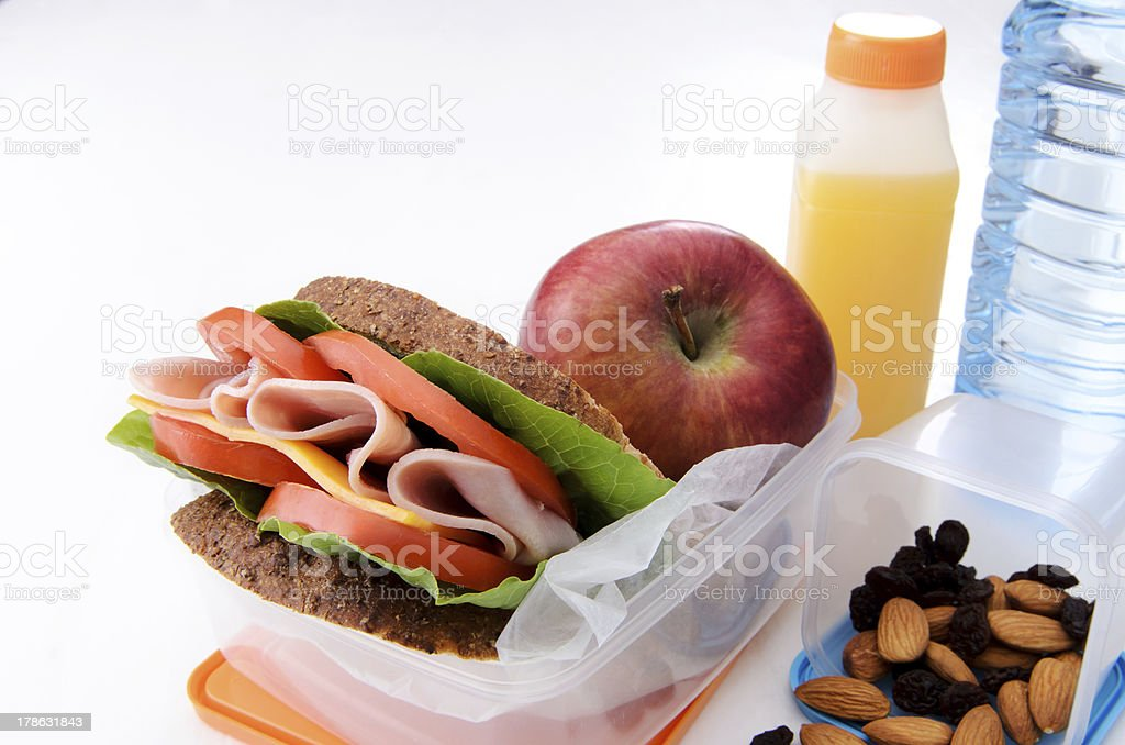 A lunch with a delicious ham sandwich royalty-free stock photo