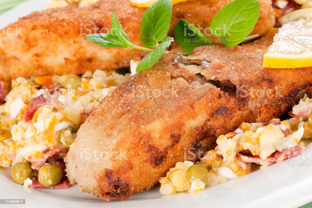 Lunch with fried carp and potatoe salad royalty-free stock photo
