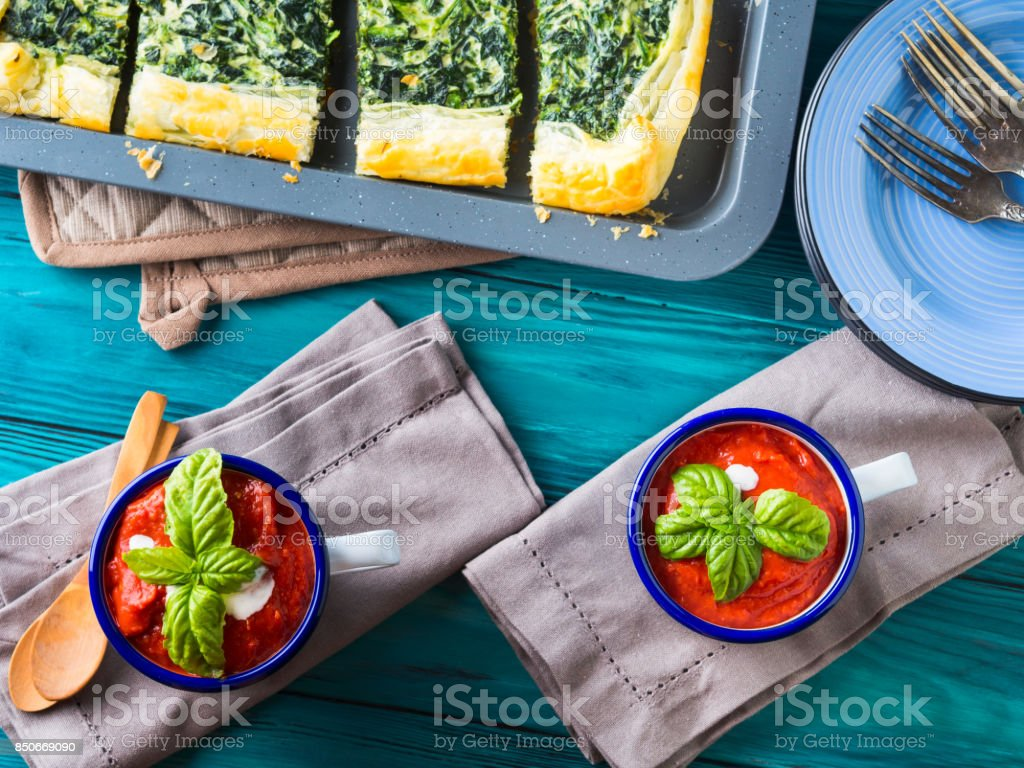 Lunch with soup and spinach quiche on table stock photo