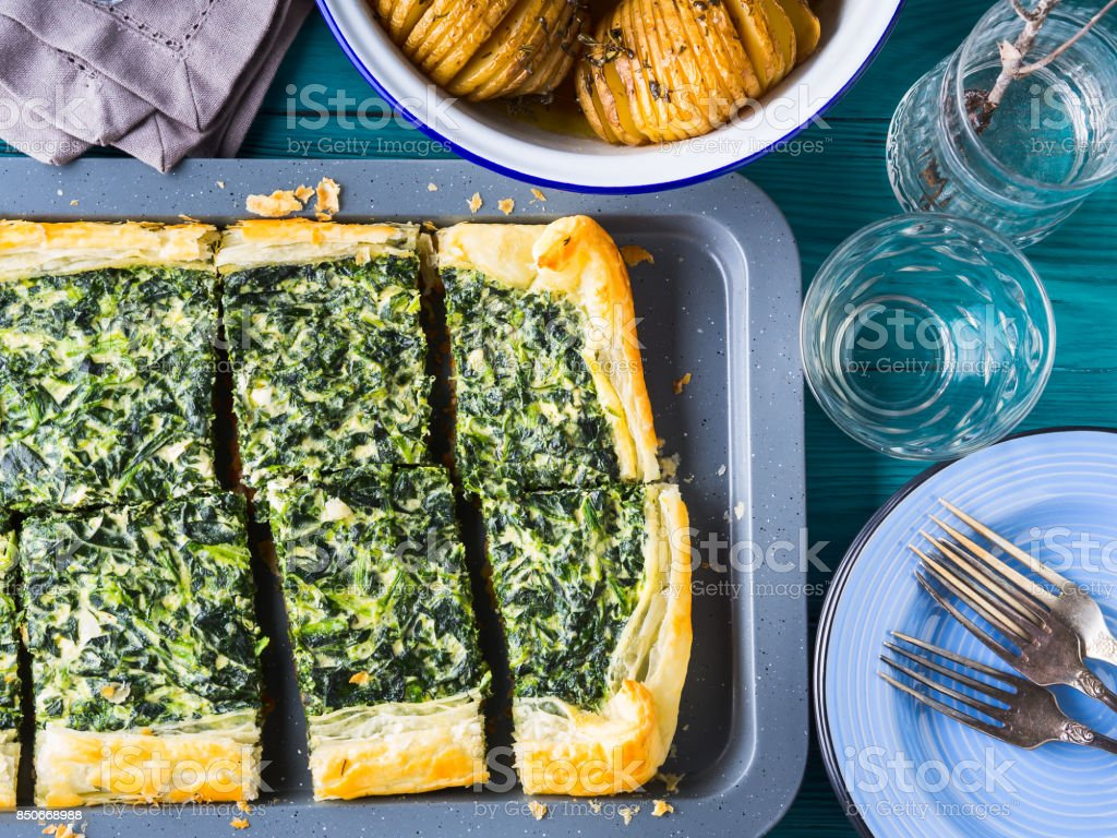 Lunch with spinach quiche and potatoes stock photo