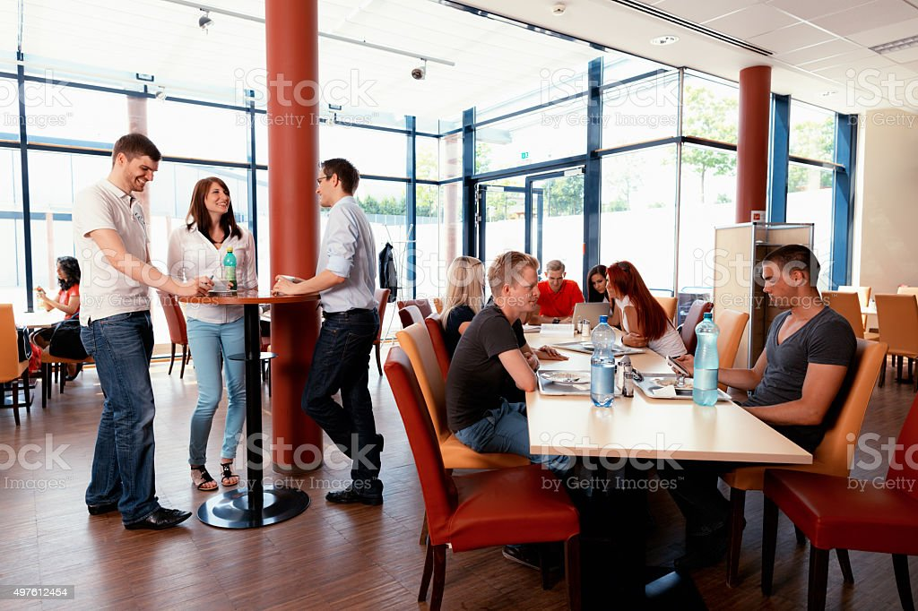 lunchtime in college restaurant stock photo