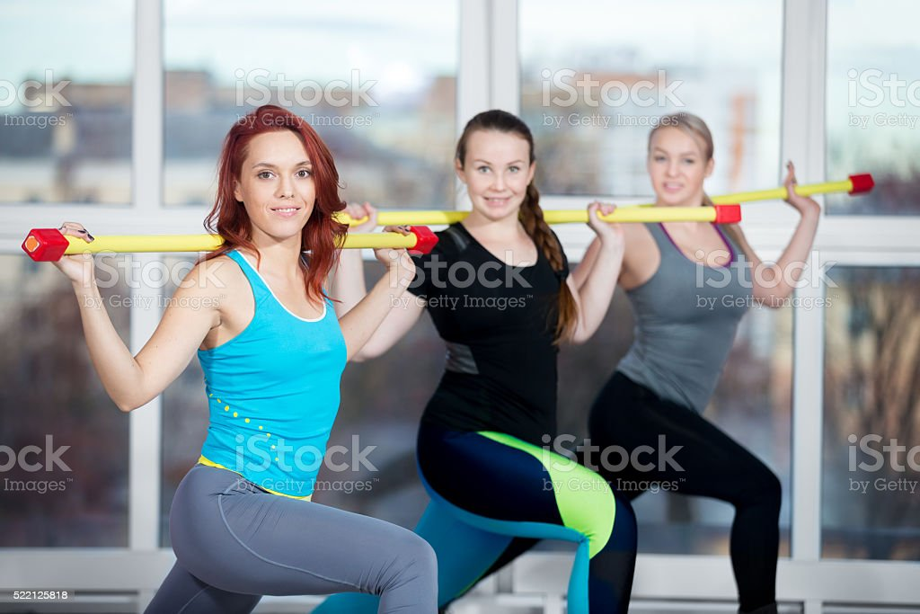 Lunges with weight bar stock photo