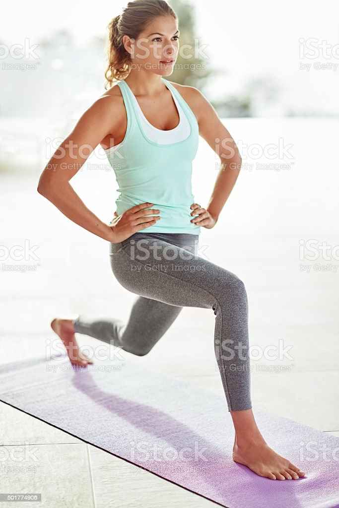 Lunging towards her fitness goals stock photo