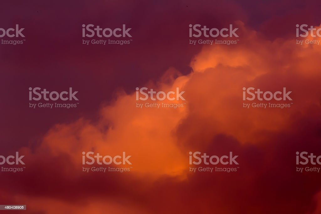 Lush clouds in fiery red tones stock photo