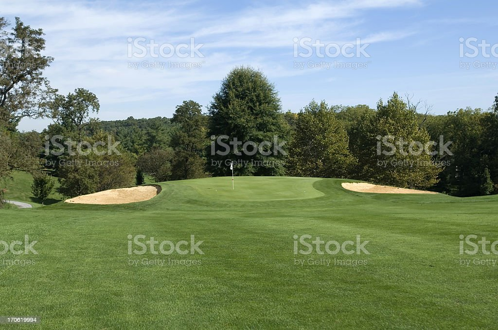 Lush green fairway looking towards the green on a sunny day  stock photo