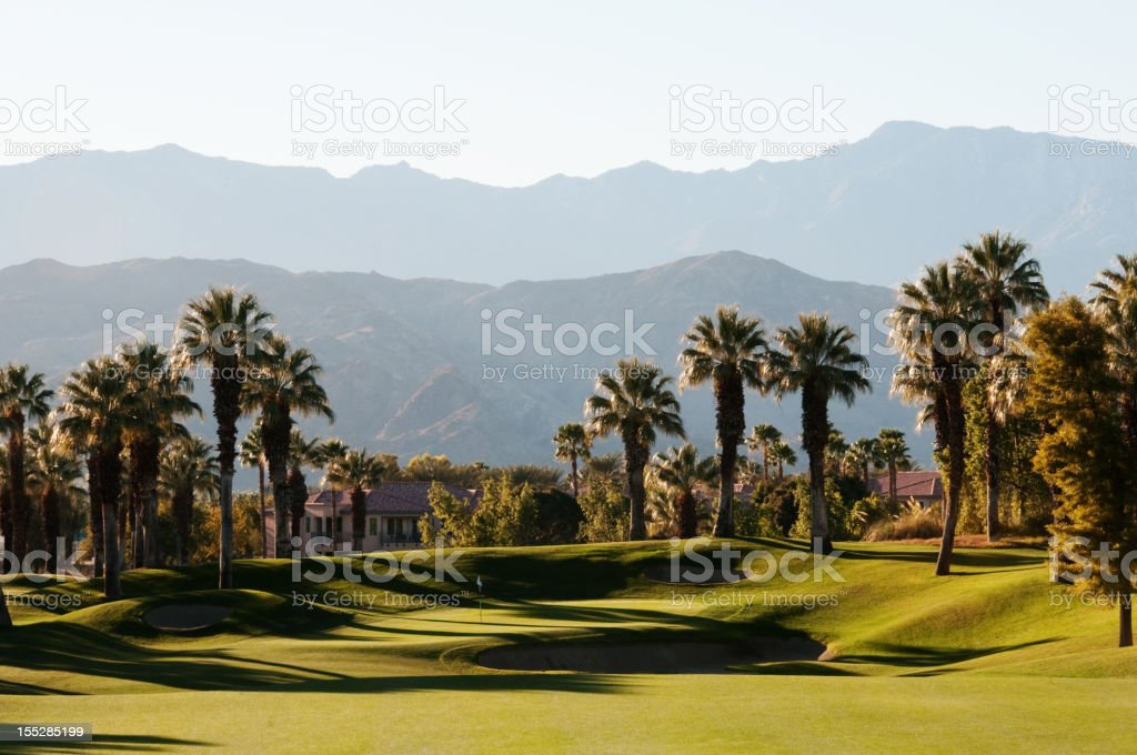 Lush green golf course in the Palm Springs desert stock photo