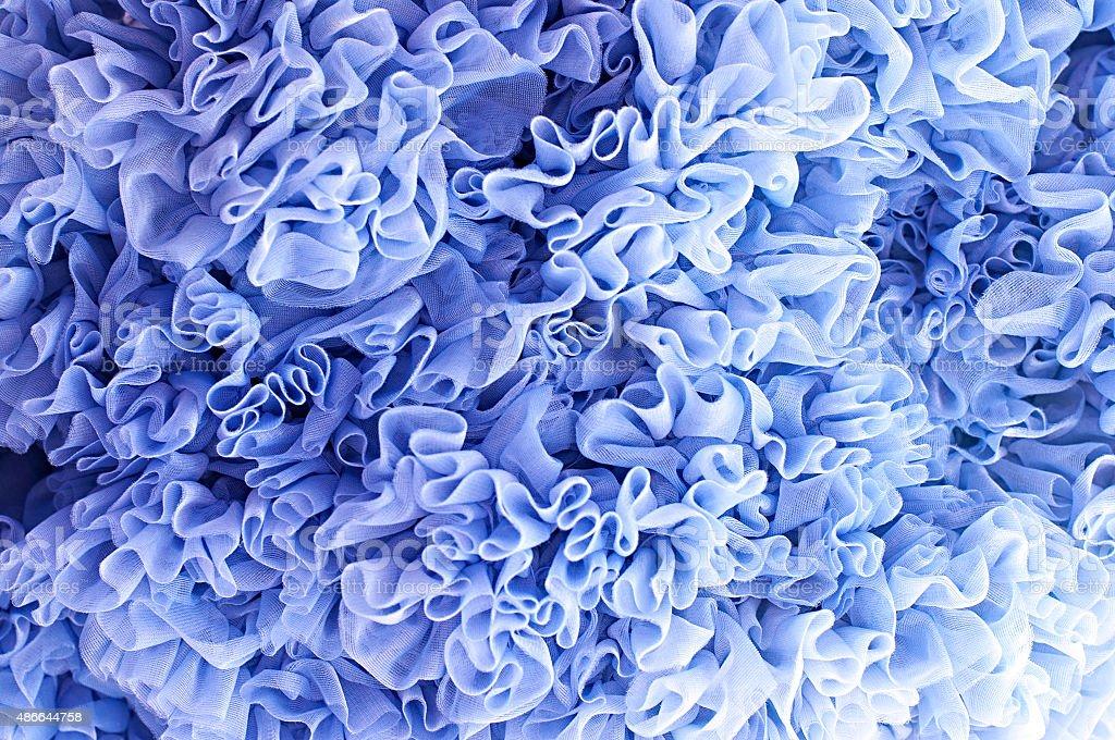 Lush her skirt. Blue background flounces stock photo