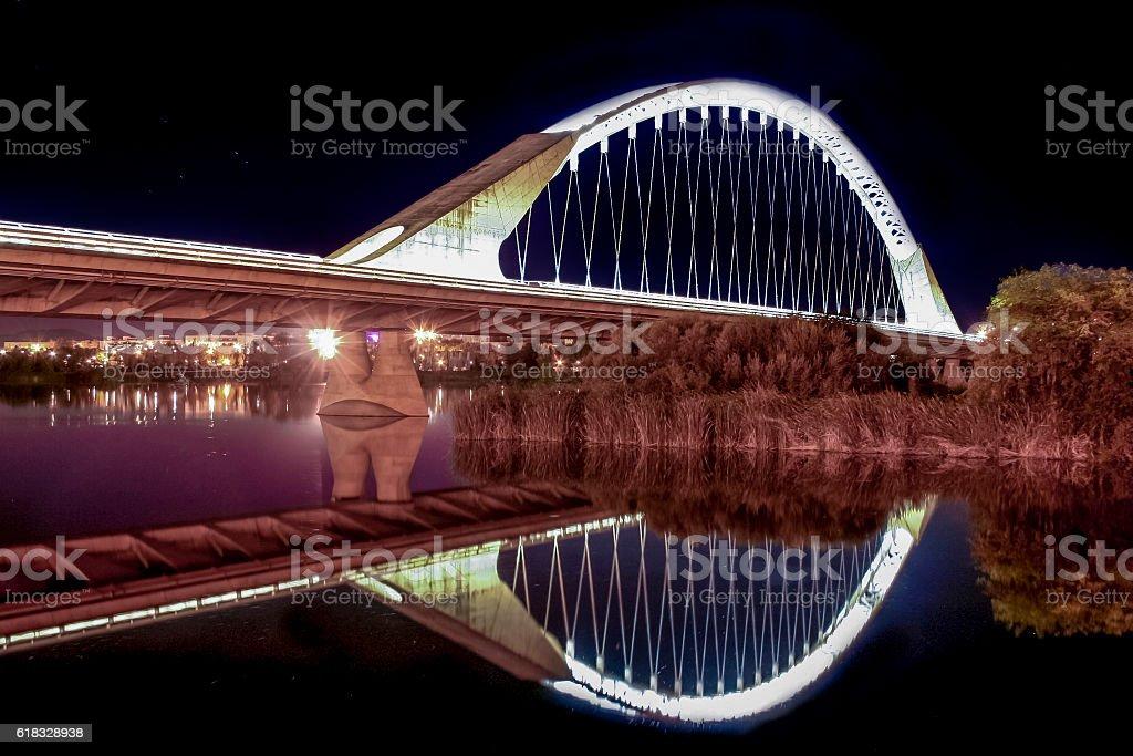 Lusitania bridge over Guadiana River at night stock photo