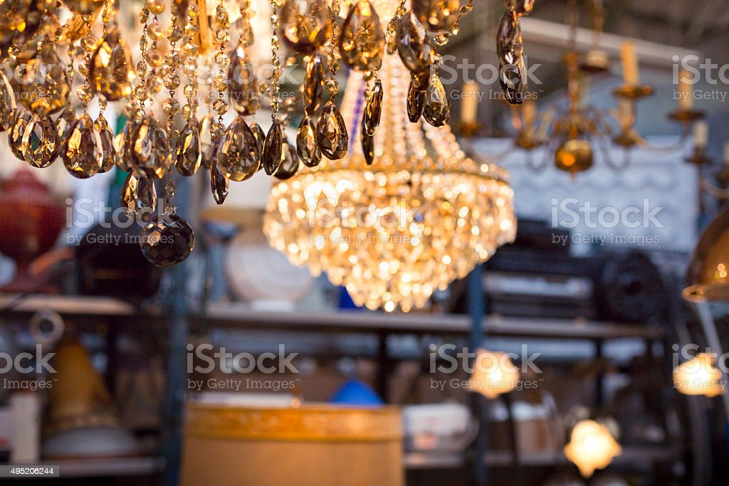 luster on a flea market with other ceiling lights stock photo
