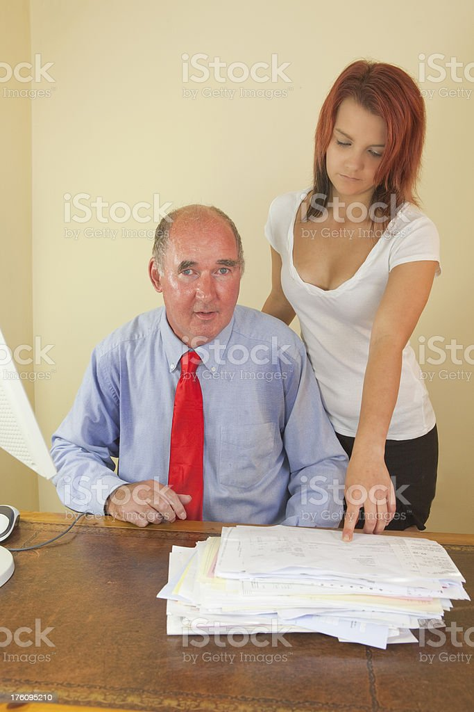 Lustful Man With His Innocent Young Co-worker stock photo
