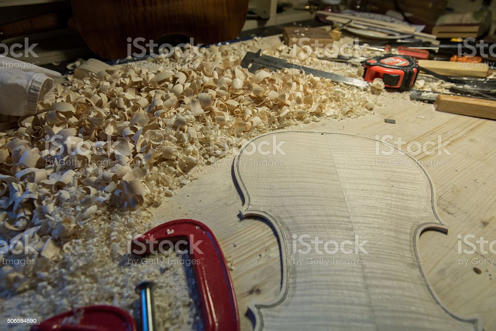 Lute maker building violin stock photo