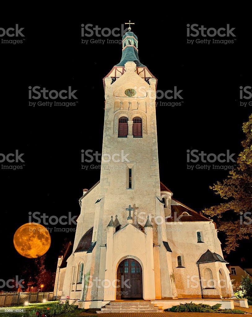 Lutheran church at moonrise, Dubulti, Jurmala, Latvia. stock photo