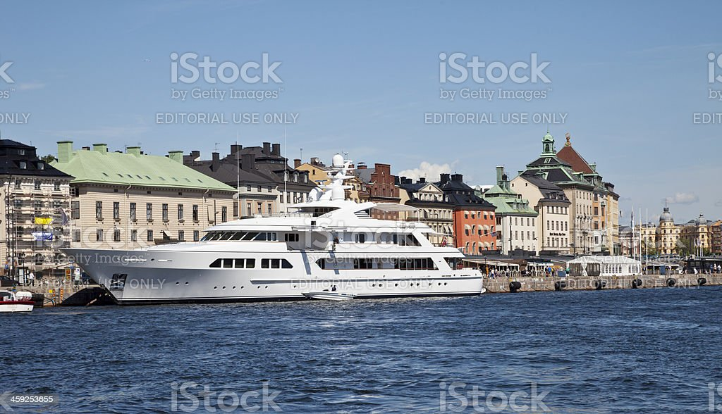 Luxary yacht at anchor outside Old City Stockholm stock photo