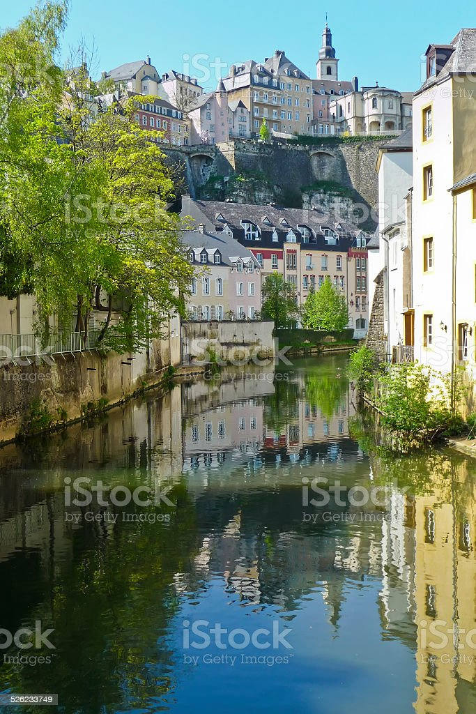 Luxembourg City, refelcted in Pétrusse river - Stock Image stock photo