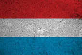 Luxembourg flag on an old grunge background