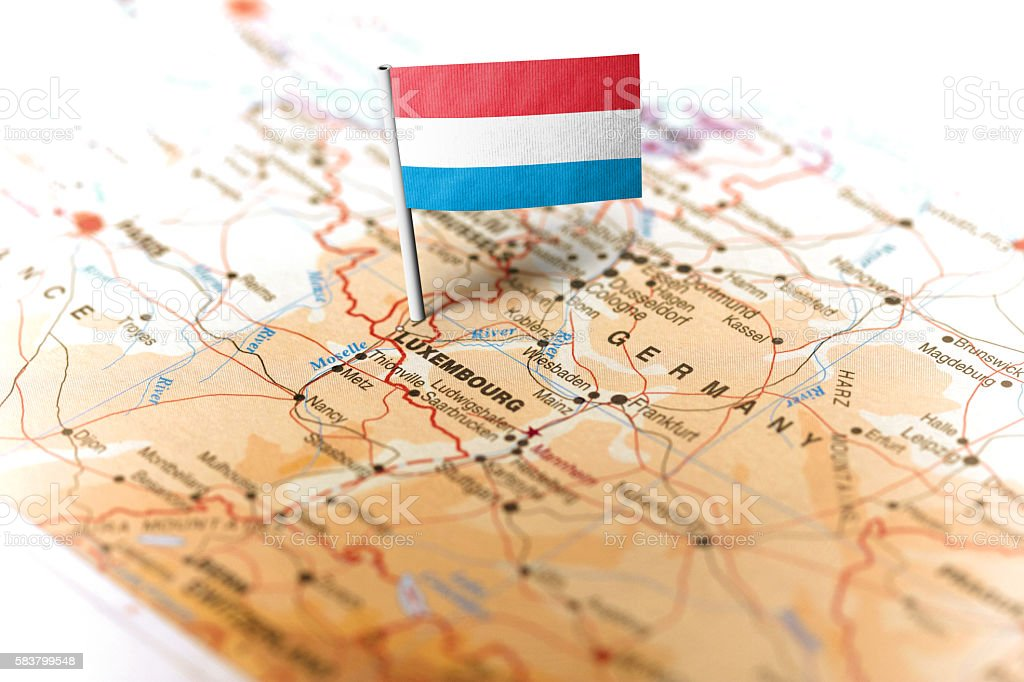 Luxembourg pinned on the map with flag stock photo